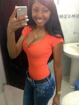 Cheerful black teens takes self-shot..