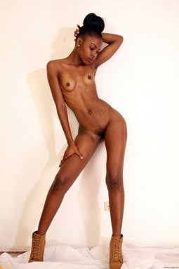 Lean ebony chick with small tits and..