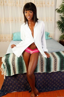 Slender brown milf takes a white robe...